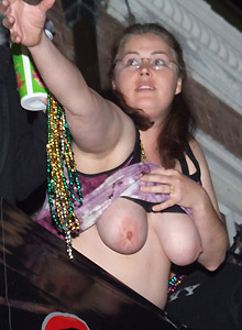 Horny Milf Shows Off Her Tits At Mardi Gras - Picture 3